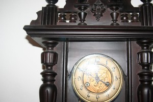 Old wall clock with pendulum