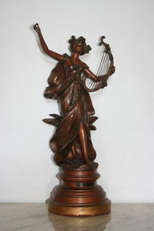 Woman playing the harp sculpture